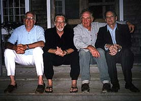 all four brothers on the step's of the packet co.
